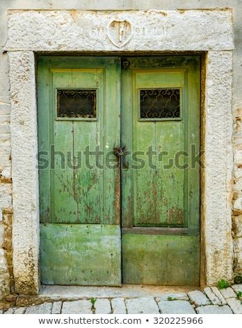 old ragged shabby wooden door with wrought iron bars Stock photo © vlaru