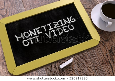 Monetizing OTT Concept Hand Drawn on Chalkboard. Stock photo © tashatuvango