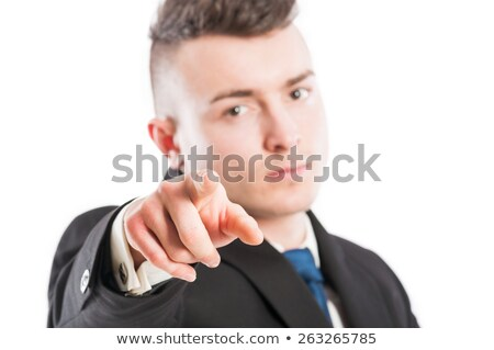 Business man with suit poiting finger at the camera acting as executive manager, boss or employer Stock photo © Patramansky