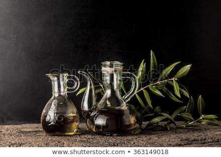 Olives and olive oil in vintage jar Stock photo © marimorena