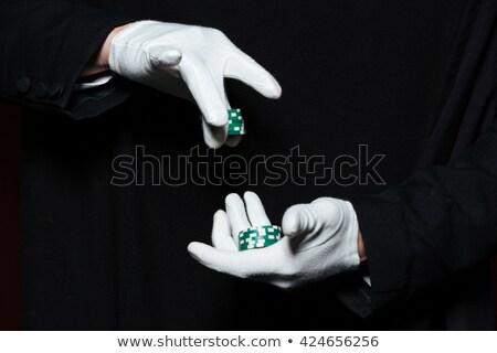 Mãos homem mágico branco luvas Foto stock © deandrobot