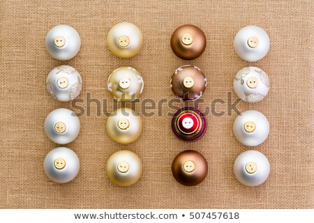 Neat rows of Christmas ornaments on burlap Stock photo © ozgur