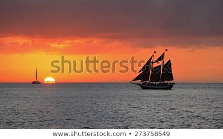 Romántica puesta de sol clave oeste reflexión océano Foto stock © meinzahn