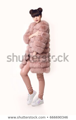 Esmer gülen genç kız pembe kürk genç Stok fotoğraf © Victoria_Andreas