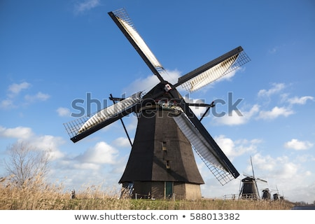 The old Dutch windmills, Holland, rural expanses . Windmills, the symbol of Holland. Stock photo © mcherevan