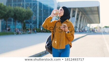 Walking and sipping. stock photo © Fisher