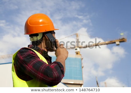 builder talking on a mobile phone stock photo © rastudio