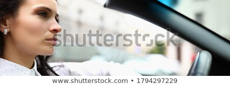 Young beautiful woman sitting in a convertible and is going to s Stock photo © vlad_star