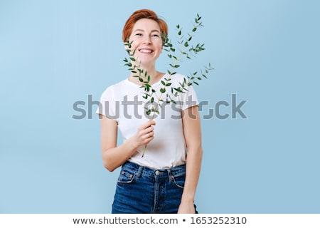 Young redhead girl holding eucalyptus Stock photo © deandrobot