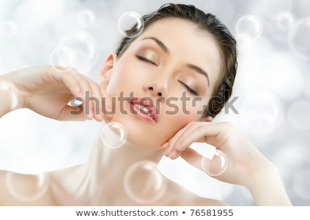 Beautiful young woman perfect face with bubbles. Skin beauty spa Stock photo © NikoDzhi