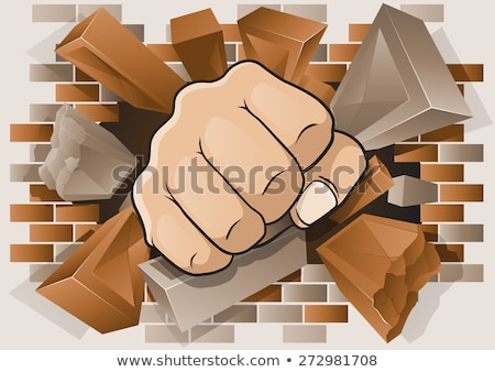 fist punching through brick wall stock photo © krisdog