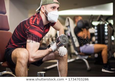 gymnasium · bank · druk · training · sterke · jonge · man - stockfoto © fisher