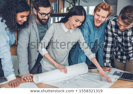 picture of team of office workers stand near poster stock photo © traimak