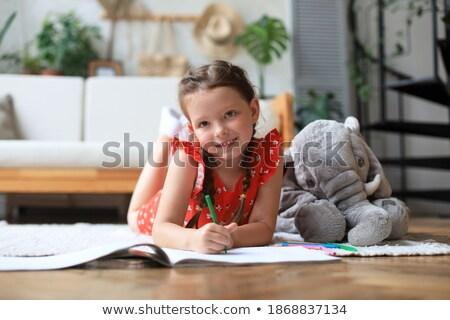 Young girl on floor with elephant Stock photo © IS2