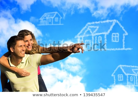 two girls lying on grass looking at sky stock photo © is2