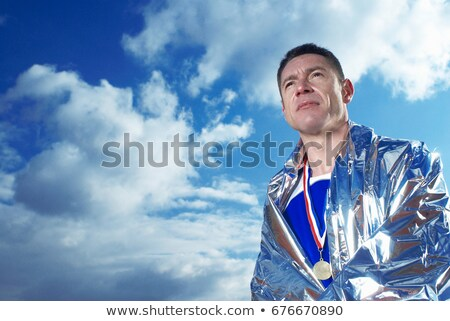 athlete in silver blanket stock photo © is2