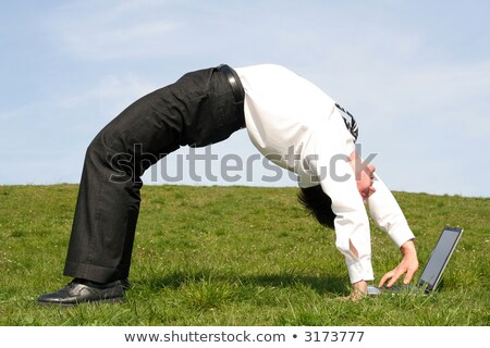business man bends over backwards stock photo © is2