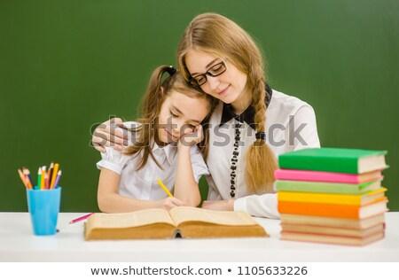 Schoolchild hugging board in classroom Stock photo © zurijeta