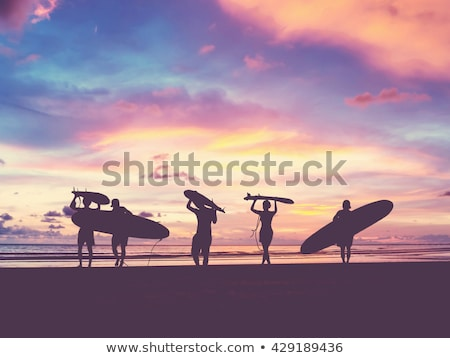 silhouette of surfer with surfboard at sunrise Stock photo © ssuaphoto