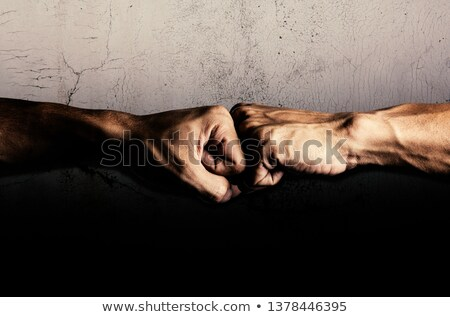beating two fighting men, strong punch Stock photo © studiostoks