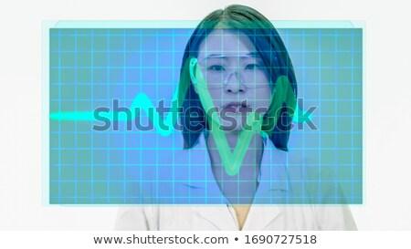 Foto stock: Doctor Analyzing Heart Cardiogram Ecg On Virtual Screen