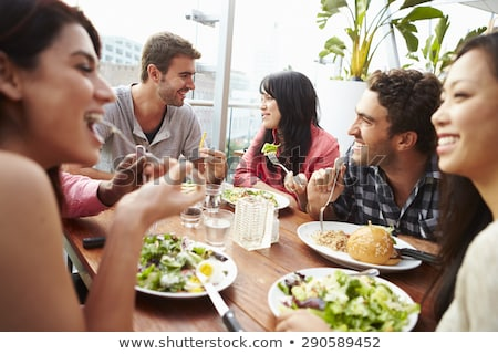 A Middle Eastern woman enjoying a meal in a restaurant stock photo © monkey_business