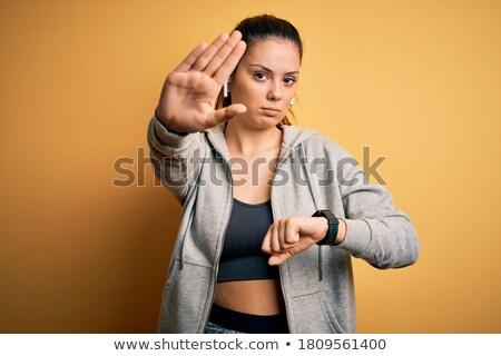 Portré komoly fiatal sportoló fülhallgató jogging Stock fotó © deandrobot