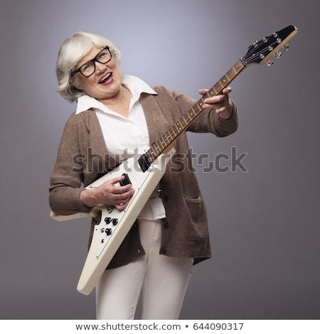 Feliz mulher estrela do rock jogar guitarra Foto stock © feedough