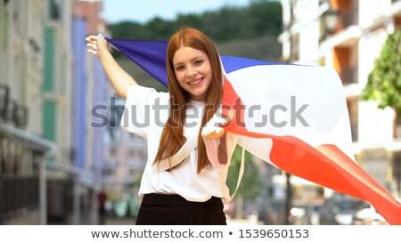 Beautiful fan teen girl holding French flag Stock photo © orensila