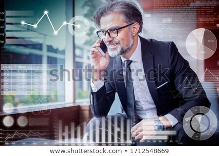 Przystojny starszy biznesmen posiedzenia lobby portret Zdjęcia stock © boggy
