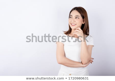 Portrait of a smiling young casual girl pretending Stock photo © deandrobot