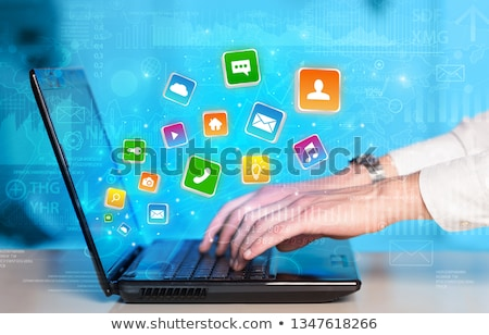Hand using laptop with bouncing application graphs and report co Stock photo © ra2studio