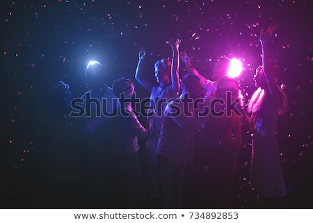 group of partying girls with flutes with sparkling wine having f stock photo © dashapetrenko