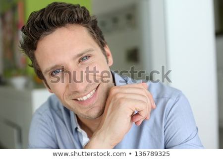 Portrait closeup of unshaved man 30s in white shirt looking at c Stock photo © deandrobot