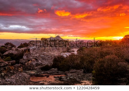 Sunset skies looking across the cliff to the distant mountains Stock photo © lovleah