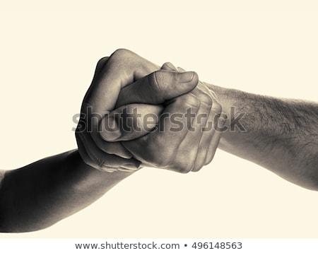 arm wrestling between businessmen stock photo © minervastock
