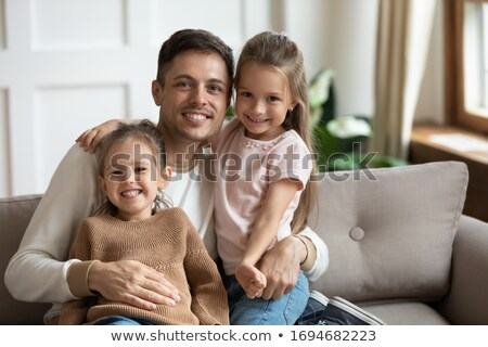 Portrait of single daddy with 2 kids at home Stock photo © Lopolo