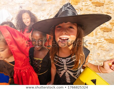 Group of laughing friends dressed in scary costumes Stock photo © deandrobot