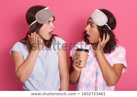 Kettő csinos megrémült lányok visel pizsama Stock fotó © deandrobot