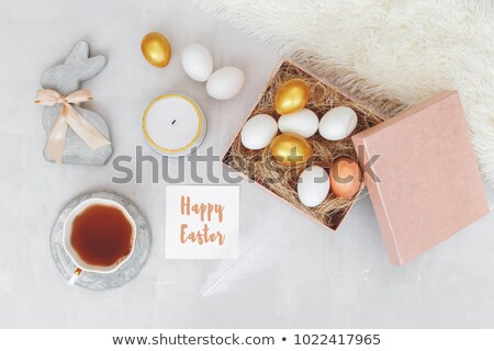 Beautiful Easter composition made of painted pink and white eggs on a green background with copy spa Stock photo © artjazz
