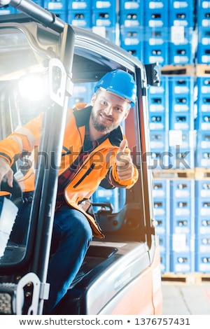 Worker showing thumbs up in logistics delivery center Stock photo © Kzenon