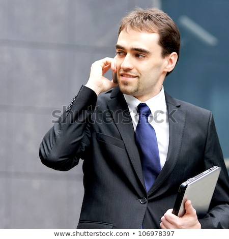 image of young director man in suit talking on smartphone and wo stock photo © deandrobot