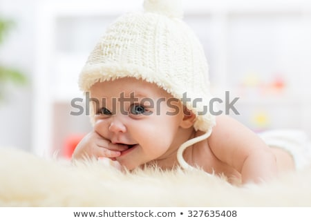 Cute baby girl on bed at home stock photo © Lopolo