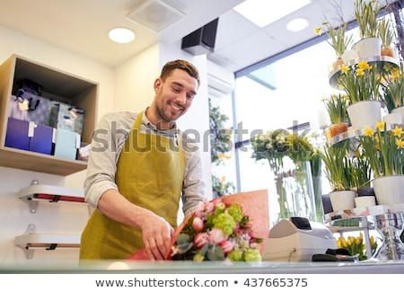 Souriant fleuriste homme petit commerce Photo stock © dolgachov