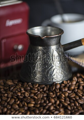 roasted coffee beans with scoop in the glass jar on a bag Stock photo © mizar_21984