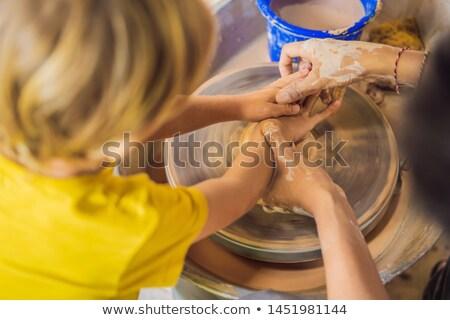 Boy doing ceramic pot in pottery workshop Stock photo © galitskaya