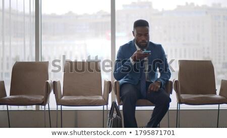 Successful entrepreneur in formalwear recording voice message on smartphone Stock photo © pressmaster