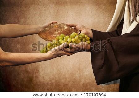 Jesus gives bread and grapes Stock photo © antonio_gravante