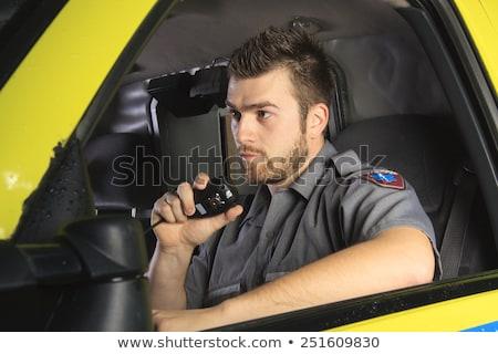 Paramedico ruota ambulanza parlando microfono medici Foto d'archivio © Lopolo