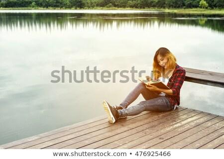 menina · adolescente · leitura · livro · sessão · grama · céu - foto stock © AndreyKr